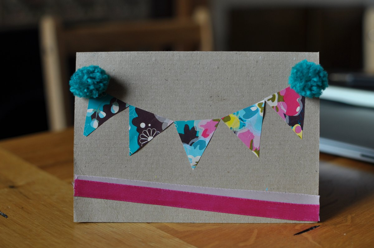 A card with floral bunting and pom poms too