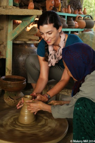 Shaping the vase on the potter's wheel